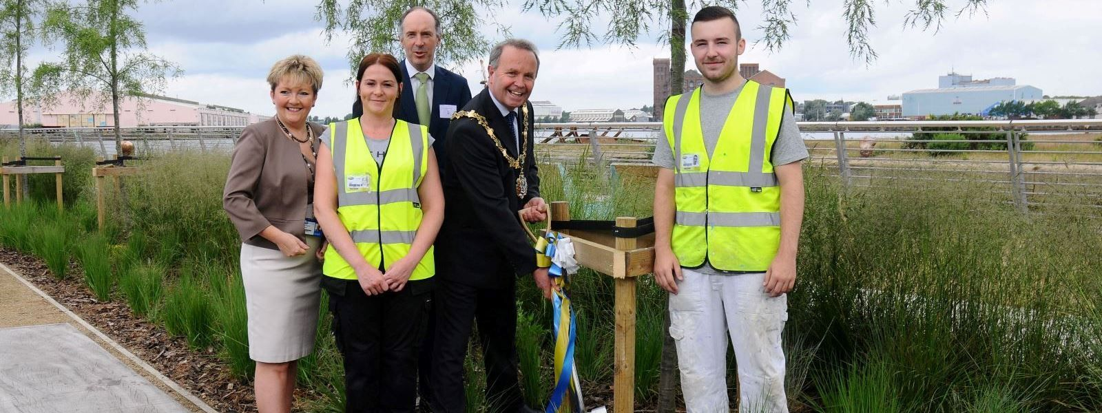 Wirral Met Principal Sue Higginson, James Whittaker of Peel Holdings and the Mayor of Wirral plant a tree at the opening of the Wirral Waters campus